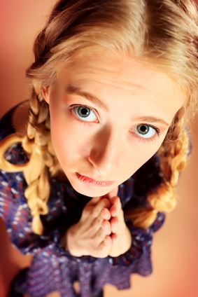 Portrait of a funny pretty blonde girl posing at studio. Retro style.