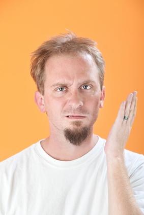 Man Gestures a Slap